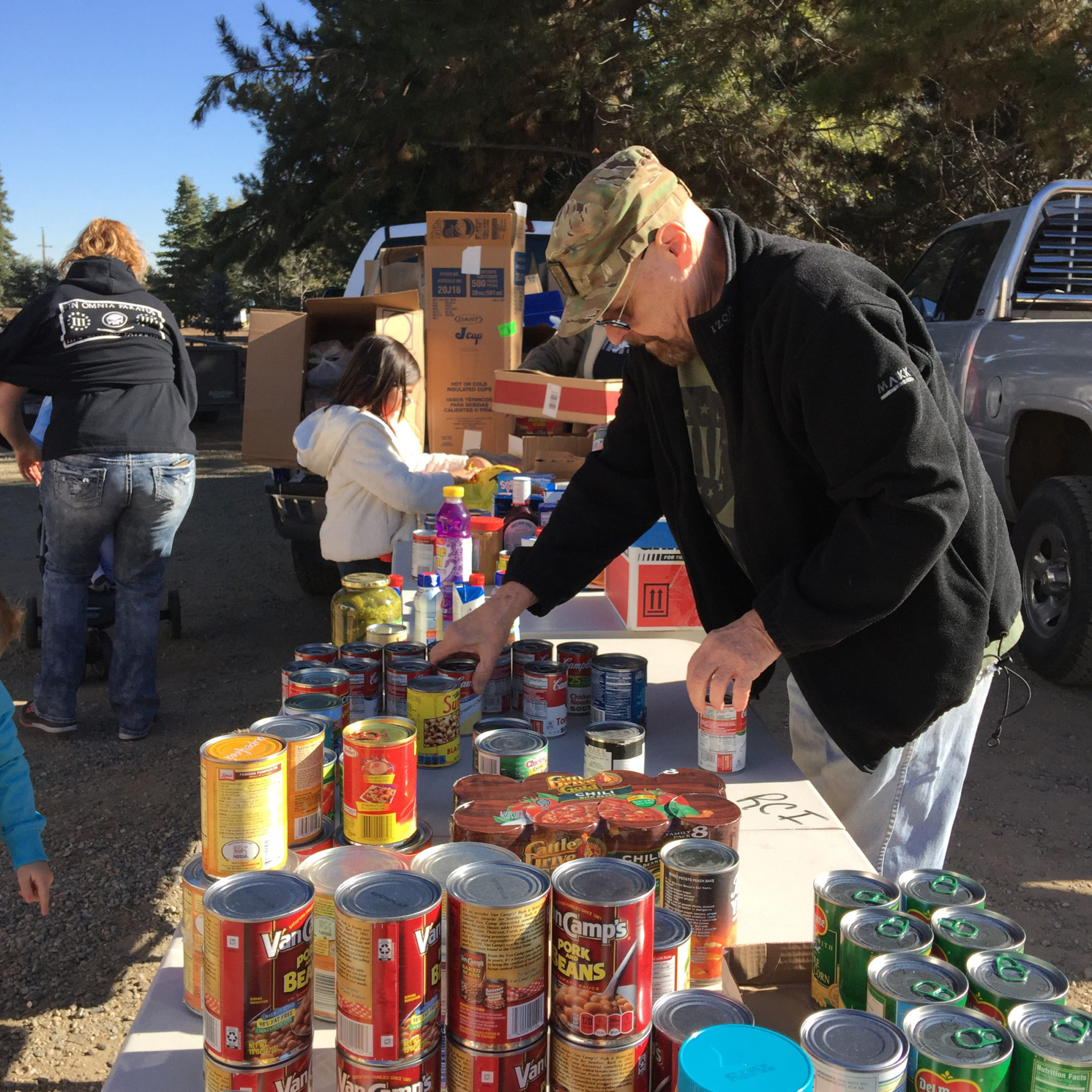Volunteer stacking canned goods